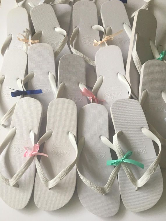 c8951793b Keep all your girly guests dancing all night long by providing them with  our comfy white flip flops. Each pair are tied together with ribbon that  will ...
