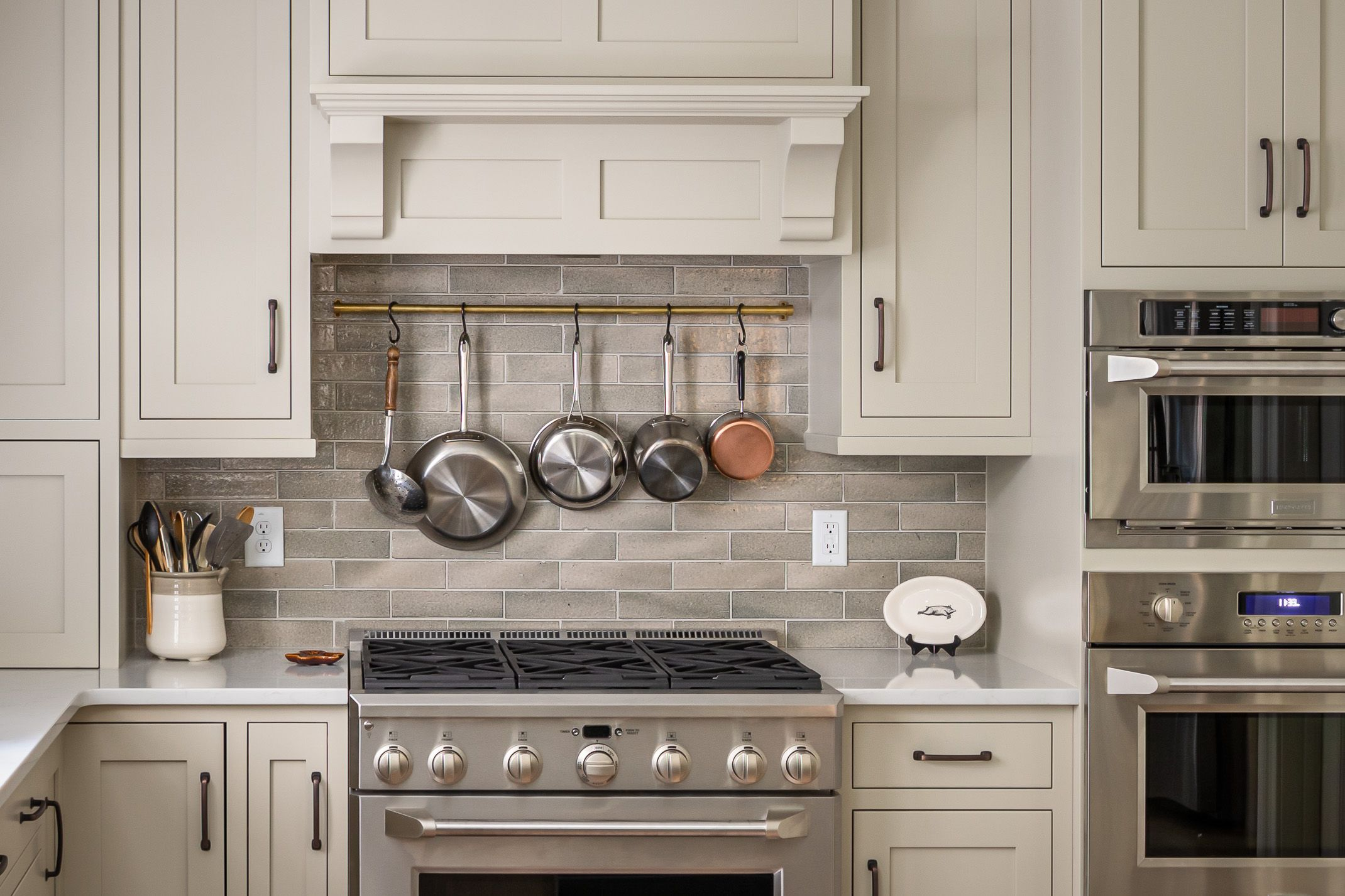 This kitchen in Cary, NC has inset shaker doors with ...