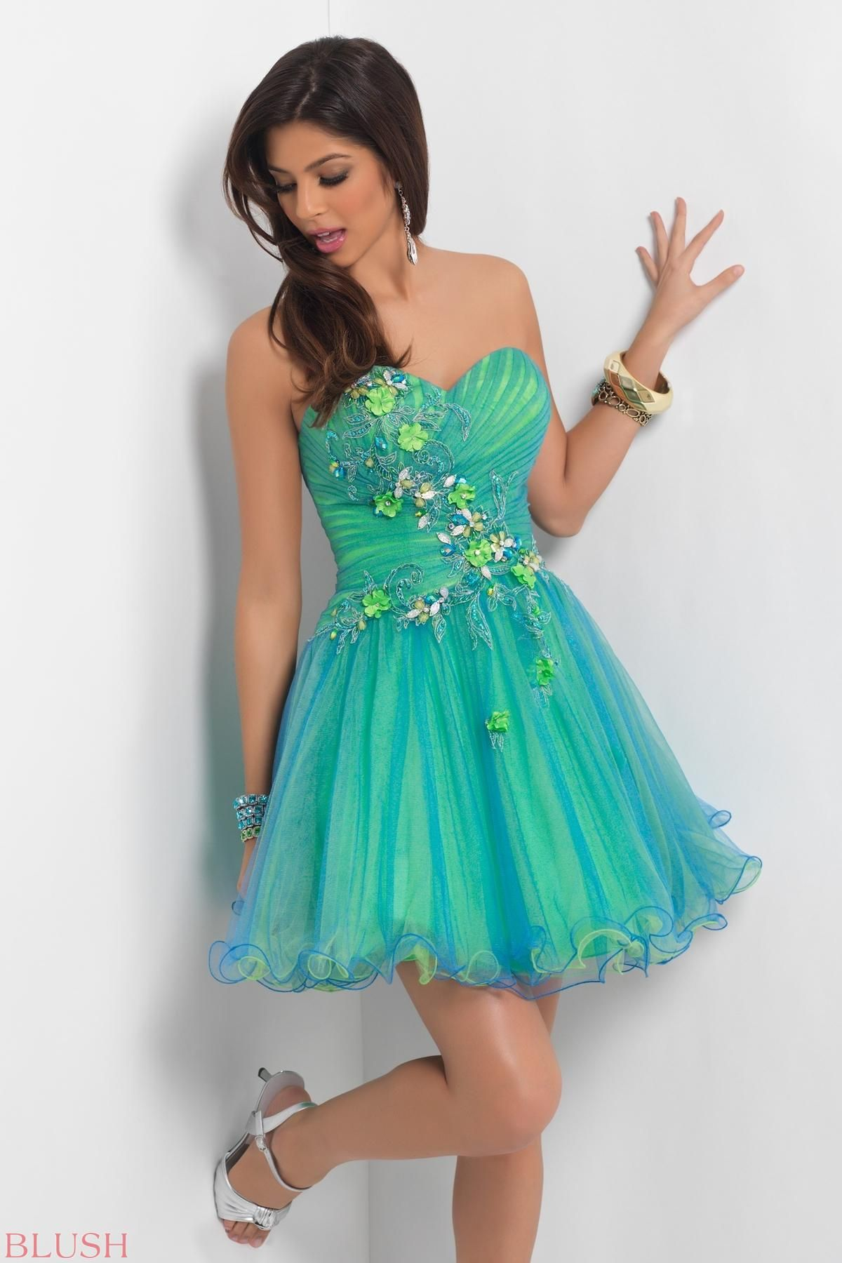 Rock the party! This hot dance dress is carressed in a spray of ...