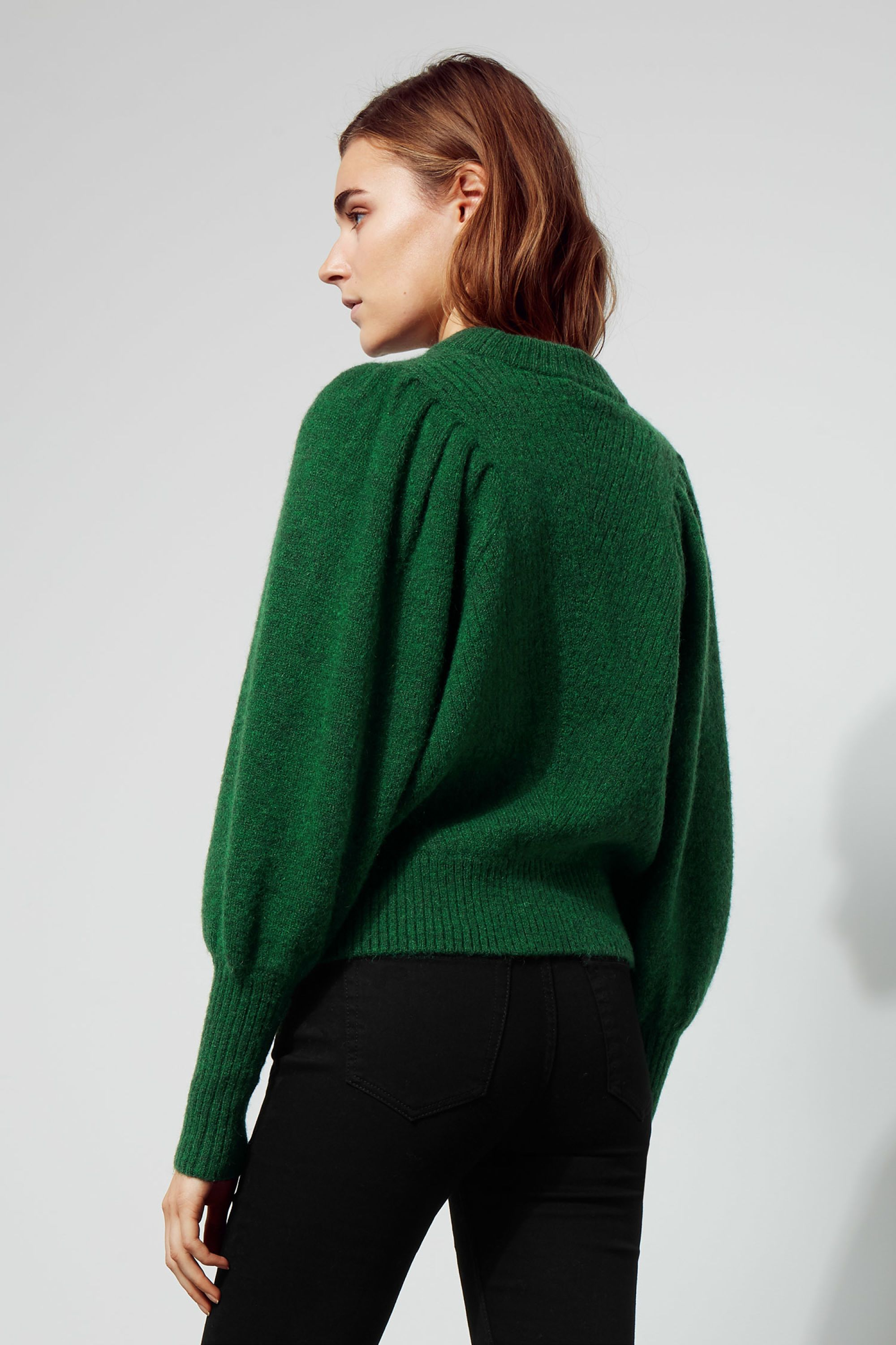 b40f51a108  p The Duet Sweater combines fine feminine details in a subtle design.  Knitted in a wool blend with just a bit of mohair for and extra soft touch