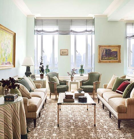 Walls dressed in gorgeous aqua silk keep the natural light flowing in this to-die-for NYC apartment - Traditional Home® / Photo: Pieter Estersohn & John Bessler / Design: Celerie Kemble