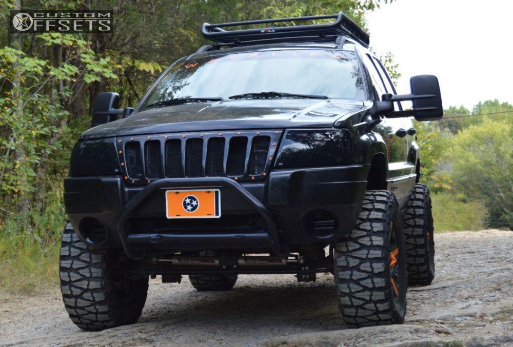 1 2004 Grand Cherokee Jeep Suspension Lift 6 Kmc Rockstars Black Aggressive 1 Outside Fender Jeep Grand Cherokee Lifted Jeep Cherokee 1999 Jeep Grand Cherokee
