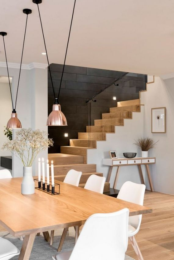 Minimal dining area and stairs. Copper and white are warmed by the use of bright woods #minimalinteriors