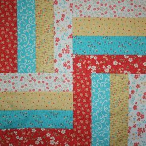 Rail fence quilt; with somewhat similar colors, actually! (I used 3 colors instead of 4)