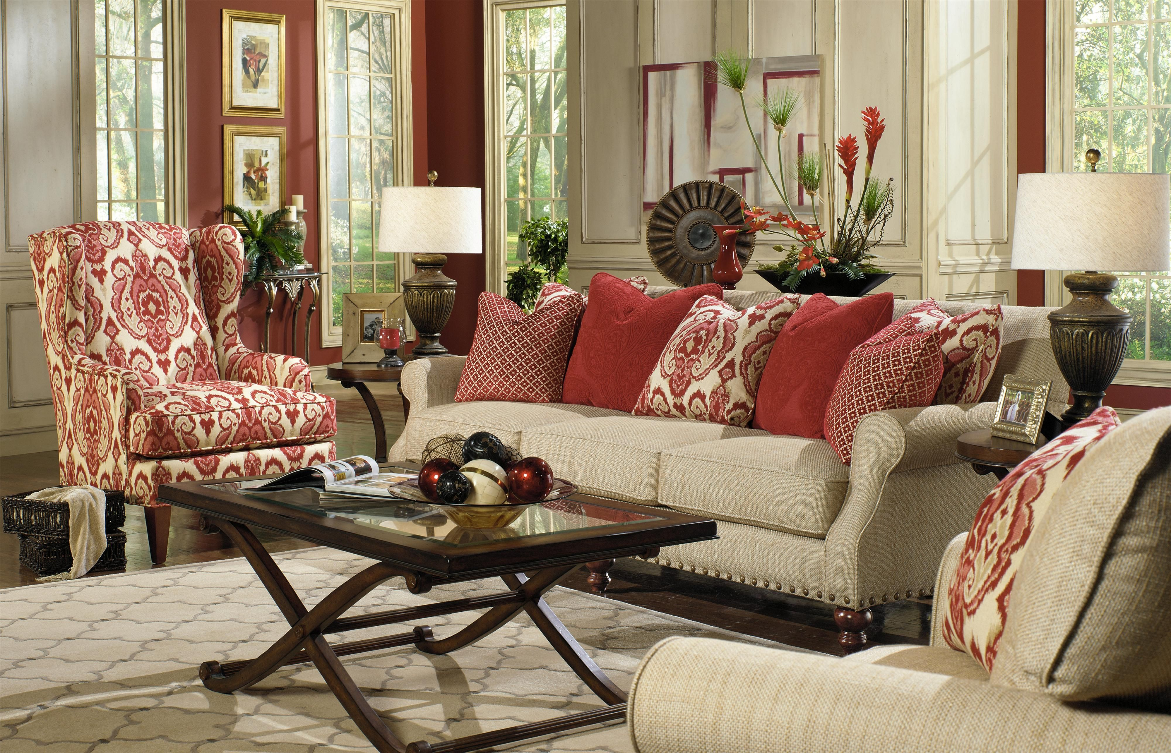 reeds furniture couch with red pillows