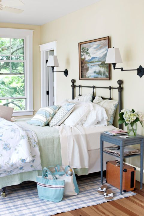 Add a Rug: Add warmth to a bedroom by placing a patterned rug underneath the bed, like in this Vermont home.