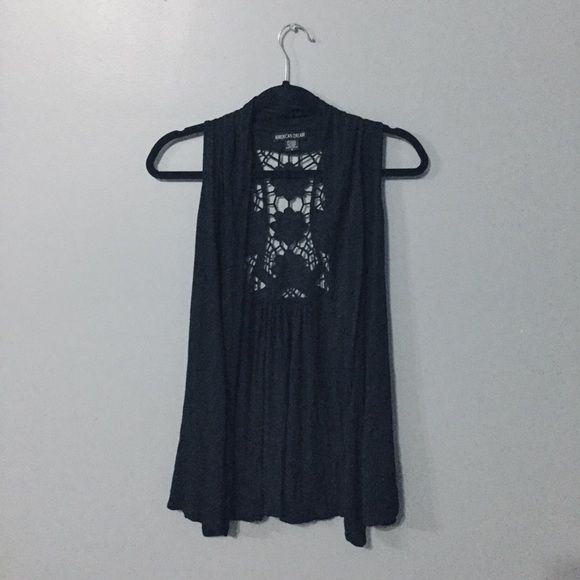 Jersey vest with detailed back Black vest with flower detailing! Worn twice,in good condition! So medium Tops
