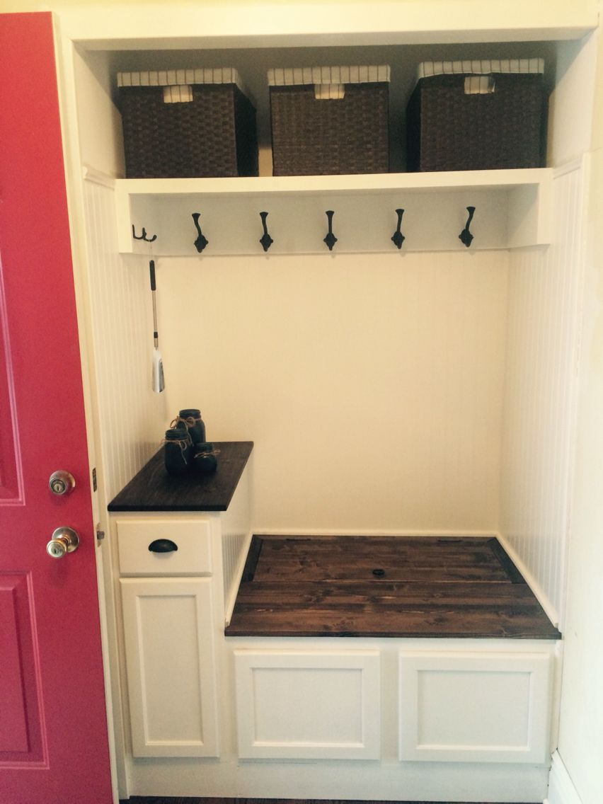 Entry way closet turned into mini mudroom. Great way to open up the foyer area. Bench opens in back for more storage. Stock cabinets as base.