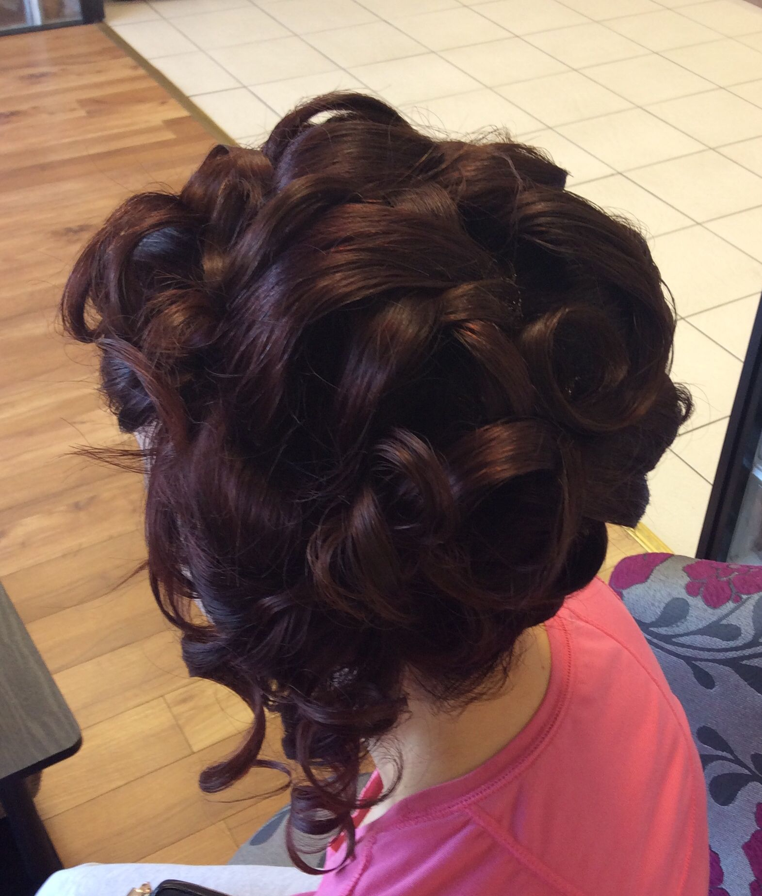 A tonged updo for a smooth finish perfect for a formal occasion