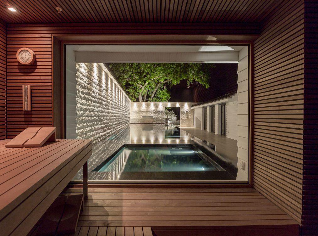 Sauna und Naturstein Kältebecken neben Pool Ideen Umbau - pool mit glaswand garten