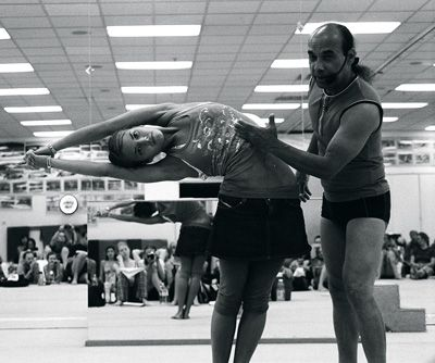 Bikram yoga Half Moon pose with Bikram himself