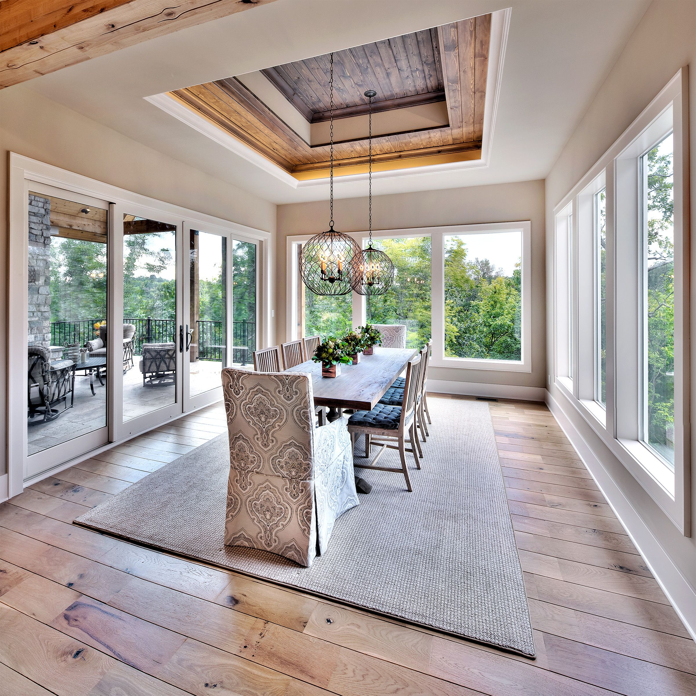 Dining area pendant lights hardwood floors surrounded by large