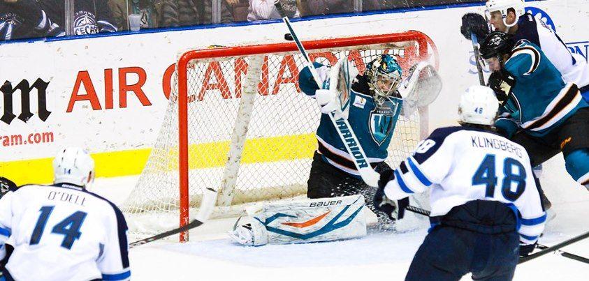 Worcester Sharks goaltender Harri Sateri makes one of his 30 saves against the St. John's IceCaps (Feb. 5, 2013).