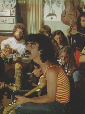 [unidentified hand with 12-string guitar (probably Ray Collins), Elliot Ingber, FZ, unidentified girl #2, JCB, unidentified girl #3, Carl Franzoni, Roy Estrada]