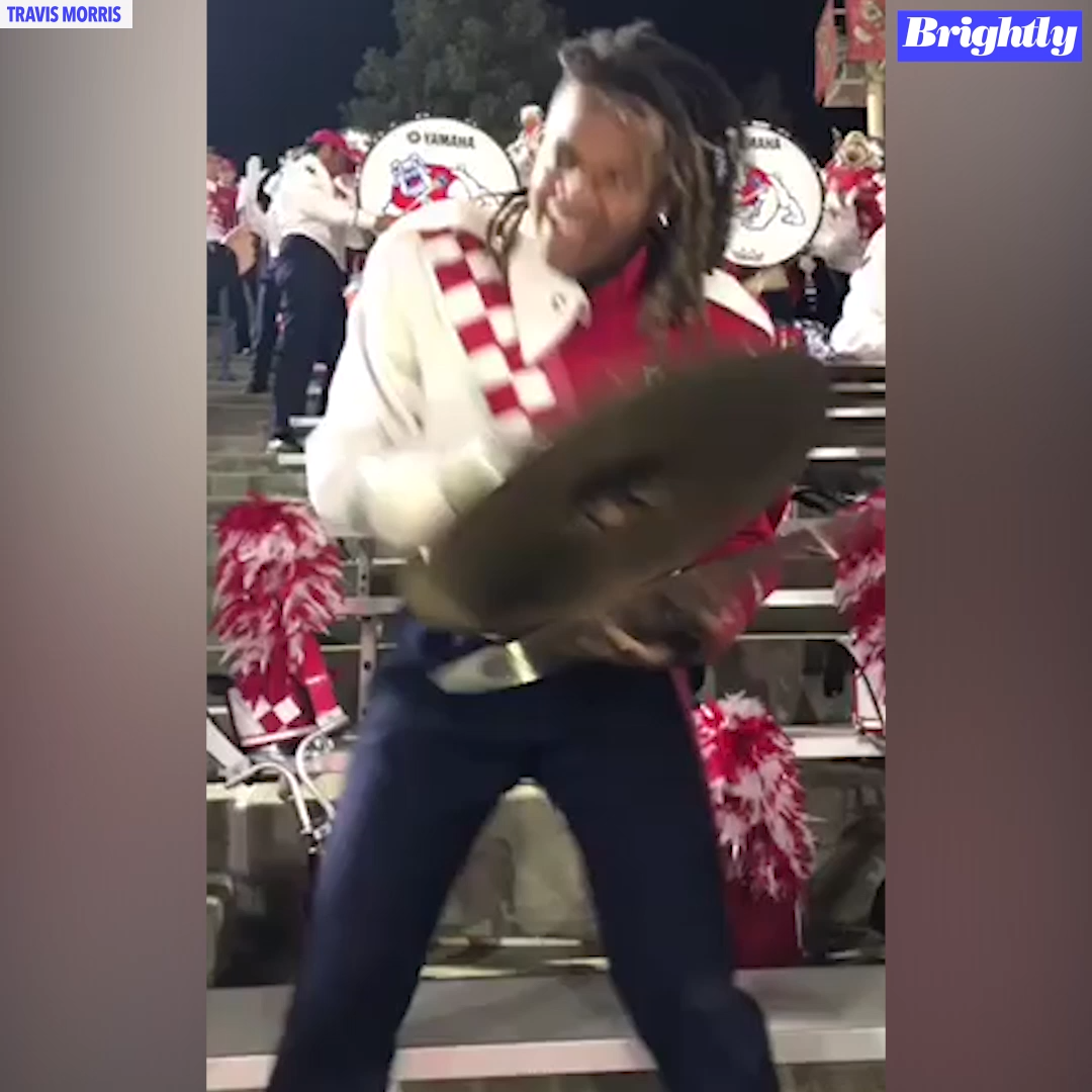 One marching band member's lively performance was captured on video as he crashed the cymbals during a college football game.