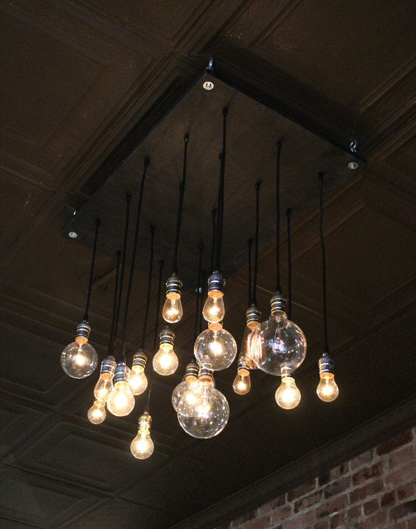 Handmade urban chandelier made from rescued plywood and recylced lamp parts loooove the hanging bulb lighting