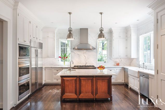 The custom kitchen island and cabinetry from Vasquez Woodmasters are ...