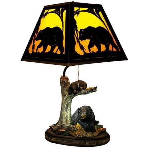 Ursos em uma lâmpada de árvore com sombra da silhueta 487