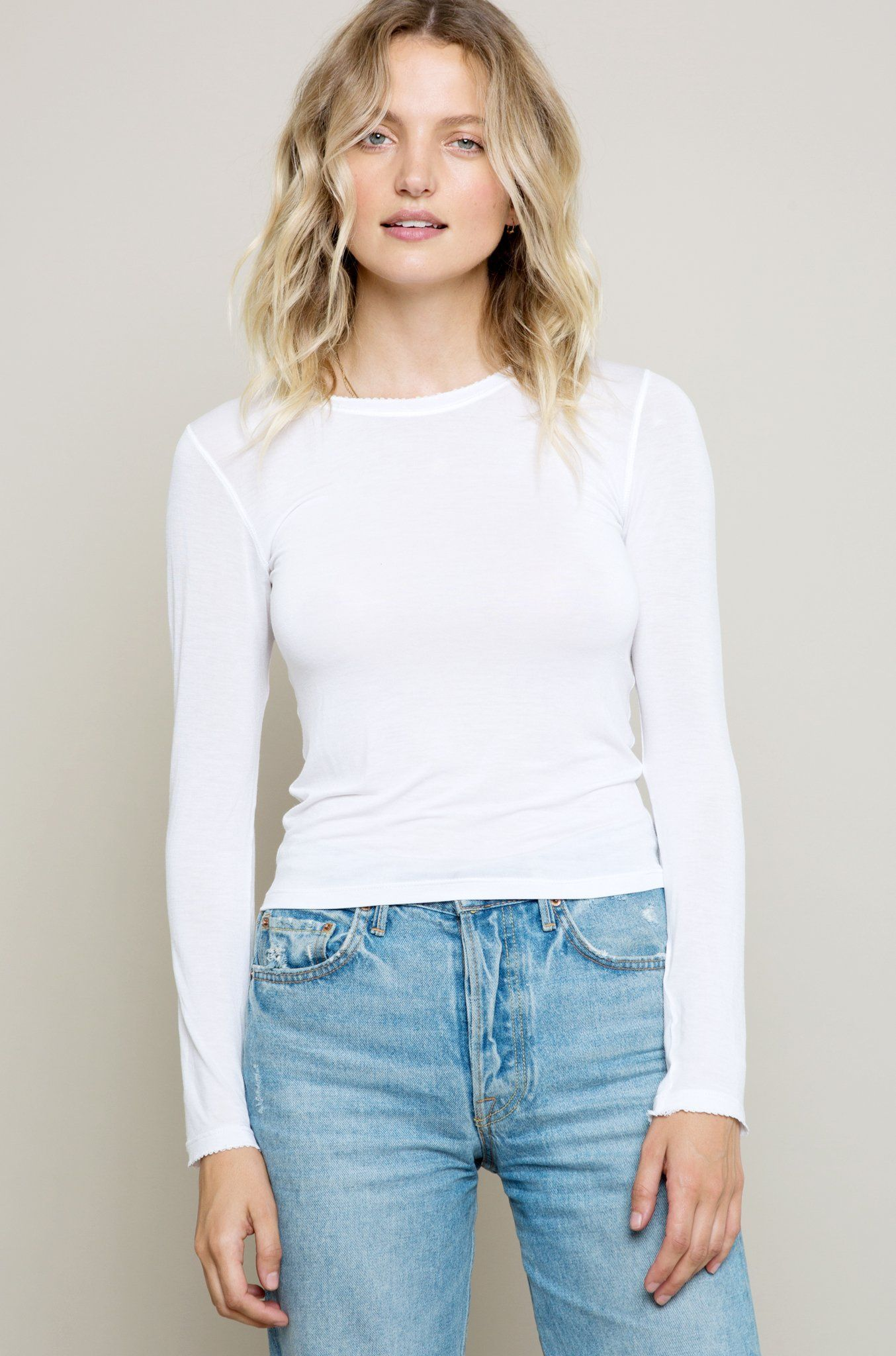 Our best-selling wardrobe staple - the perfect long, slim tee. Subtle details, like our signature picot edging, make this tee special. A great fit makes this tee a versatile wardrobe essential. Wear it all day long with jeans, then throw on a pair of heels + look chic for the evening. We also love to layer it beneath our slip dresses.  STYLE DETAILS  Silky soft, 100% cotton (delicate wash cold + lay flat to dry) Snap buttons at back neck Made in Los Angeles Amandais 5'9 + wearing a size…