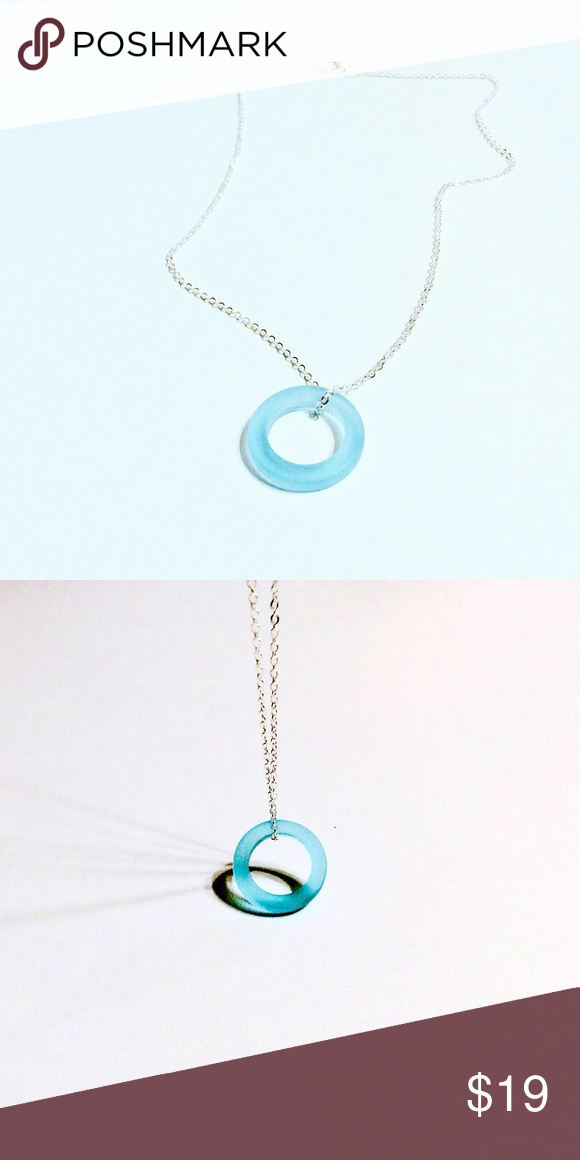 Beach glass Eternity pendant Simplify your life with this beautiful circular beach glass pendant- measures approximately a quarter in diameter and suspended on an 18 inch silver plated necklace. 🎯PRICE FIRM🎯 Boutique  Jewelry Necklaces