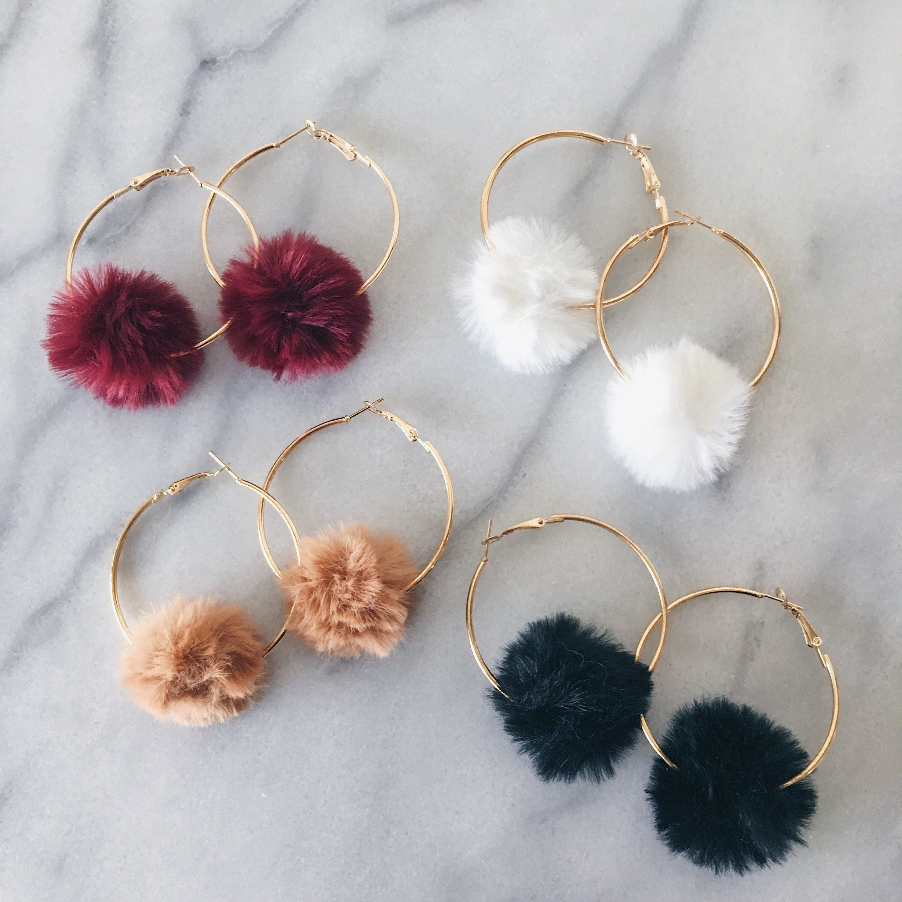 Luxurious, flirty, and fun, our Snow Bunny Puff Earrings are a stylish way to add winter glam to your outfit. Be original and take winter glam to the next level! Soft faux fur pom pom glams up a golden hoop. Fluff it out to get the round shape after taking it out of our pillow box packaging. Last Chance = FINAL SALE