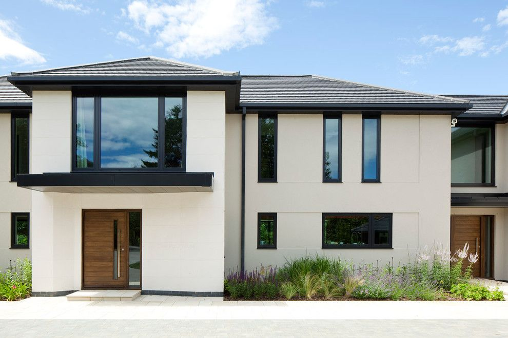 Black window trim exterior contemporary with oversized for Black and white house exterior design