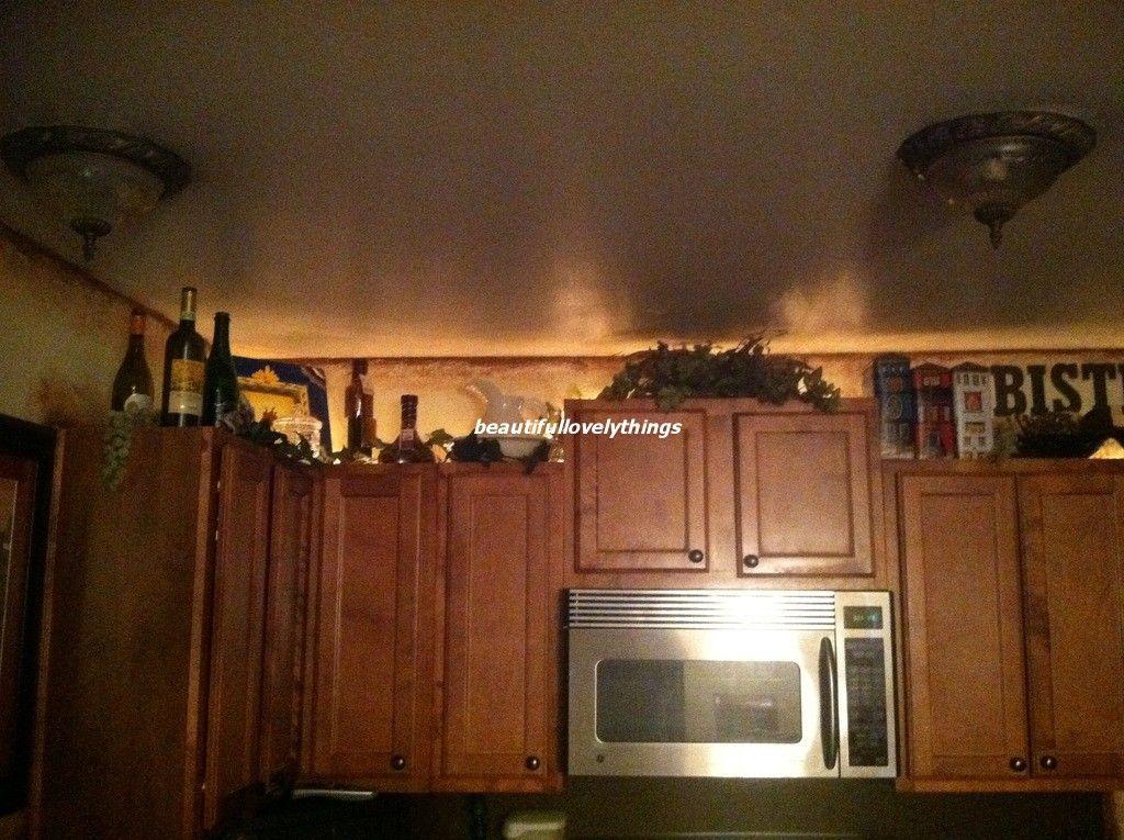 Above Kitchen Cabinet Decor Wine Theme Cabinets