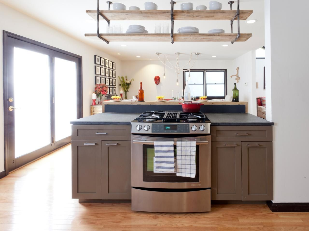 Contemporary Kitchen With Ceiling Hung Shelving Industrial Decor Kitchen Industrial Kitchen Design Kitchen Design Decor
