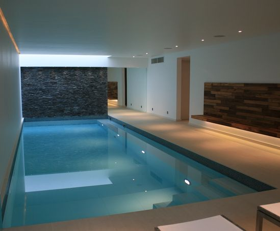 long, narrow pool in basement for swimming laps, relaxing, or