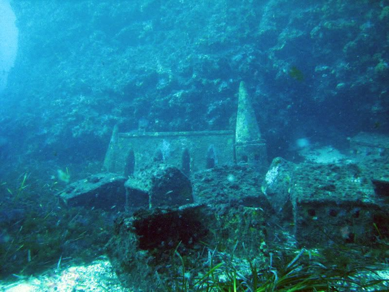 At 30 meters below sea level near a lighthouse called La Fourmigue, off the Cap d'Antibes, lies the remains of a 1000m² underwater miniature French town complete with houses and buildings up to a meter high, a church, town square, an amphitheatre and even a lawyer's office.