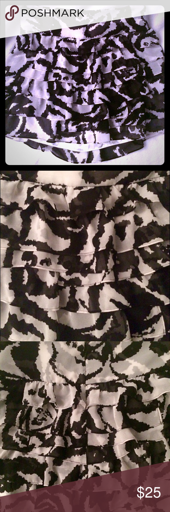 Black and white layered skirt size 0 Beautiful black and white pattern. Layers/ruffles create a lot of movement. Zips at back. Reasonable offers welcome! Express Skirts Mini