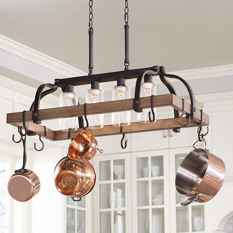 Clear Seedy Glass Adds To Industrial Look Of This Bronze Pot Rack Chandelier