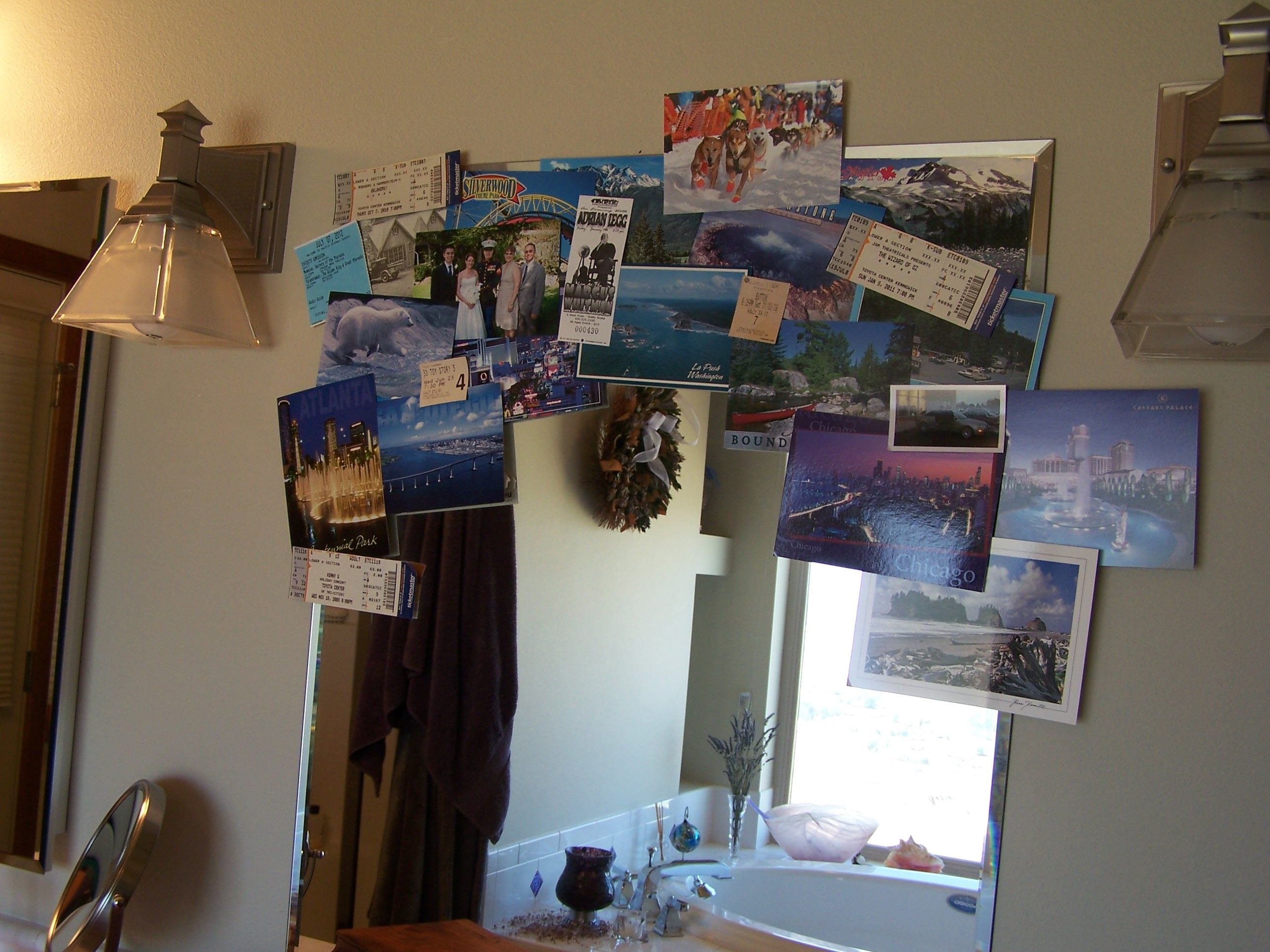 Postcards, ticket stubs, favorite photos placed around my mirror help me start the day with a smile on my face.