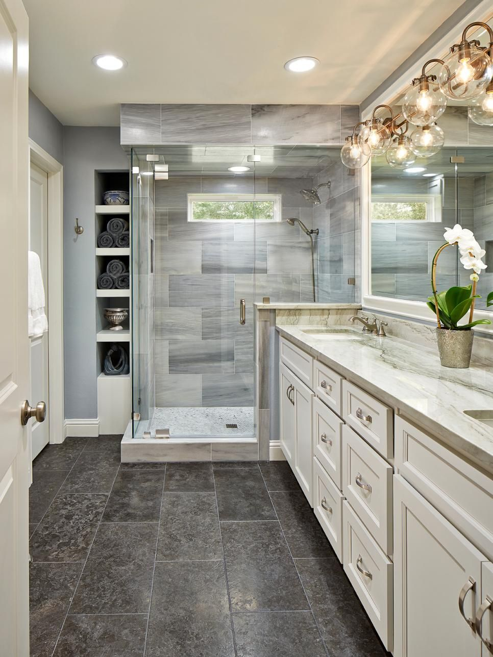 Beautiful traditional bathrooms - This Beautiful Master Bathroom Pulls Elements From Traditional And Modern Design Styles Recessed Lighting Paired