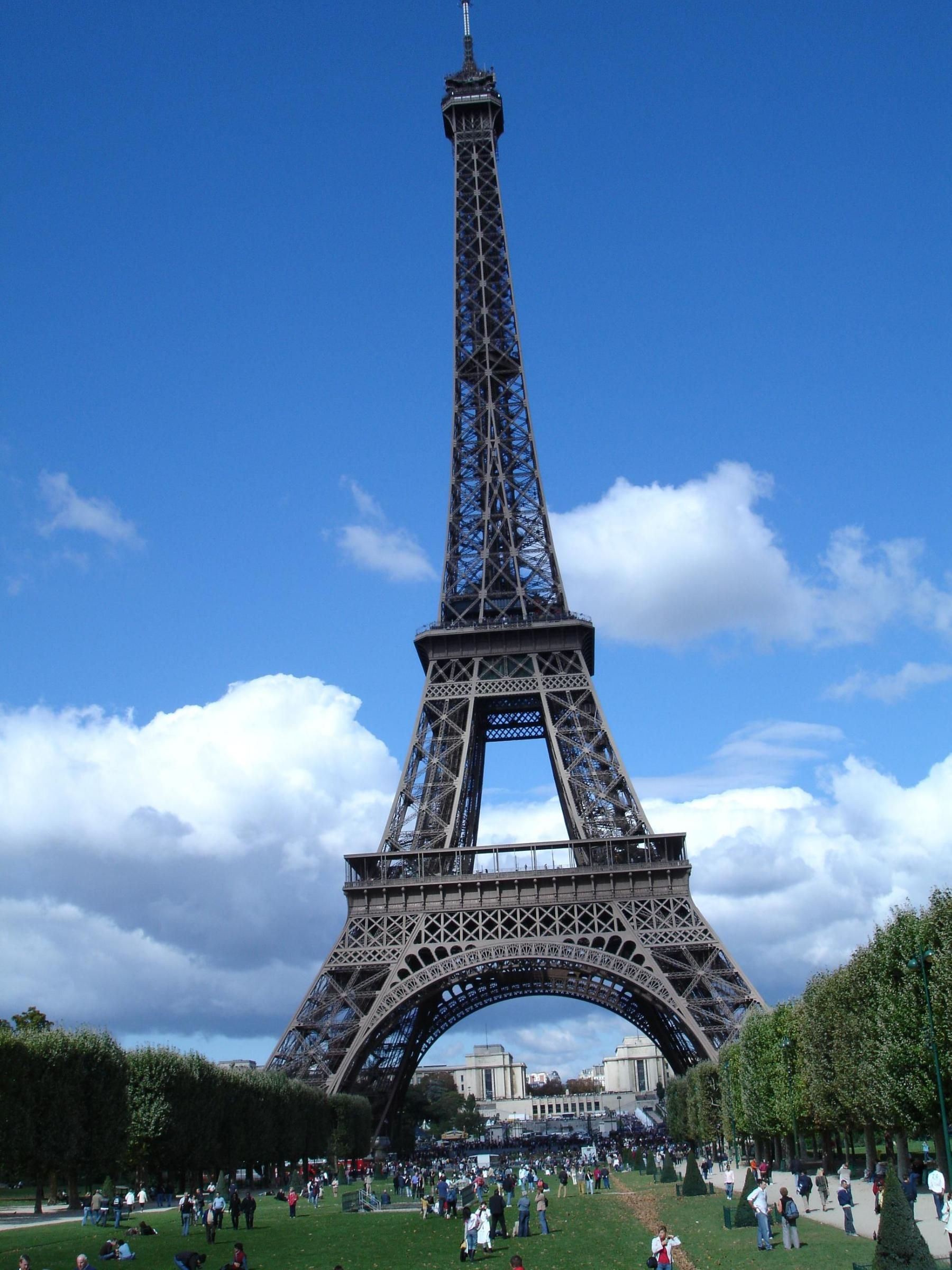 Outdoor cafe in paris with tower in background - Paris France The Eiffel Tower Nickname La Dame De Fer The Iron Lady