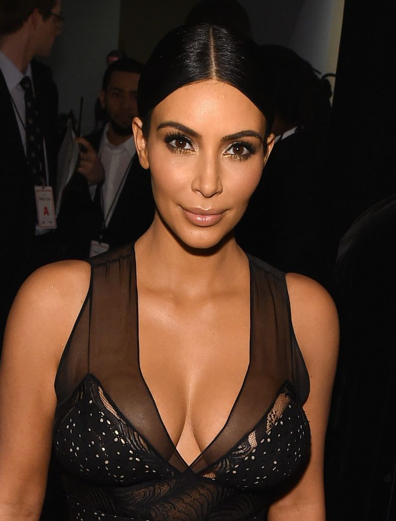 Kim Kardashian Nude Lipstick - Kim Kardashian adorned her pout with just a touch of nude lipstick.