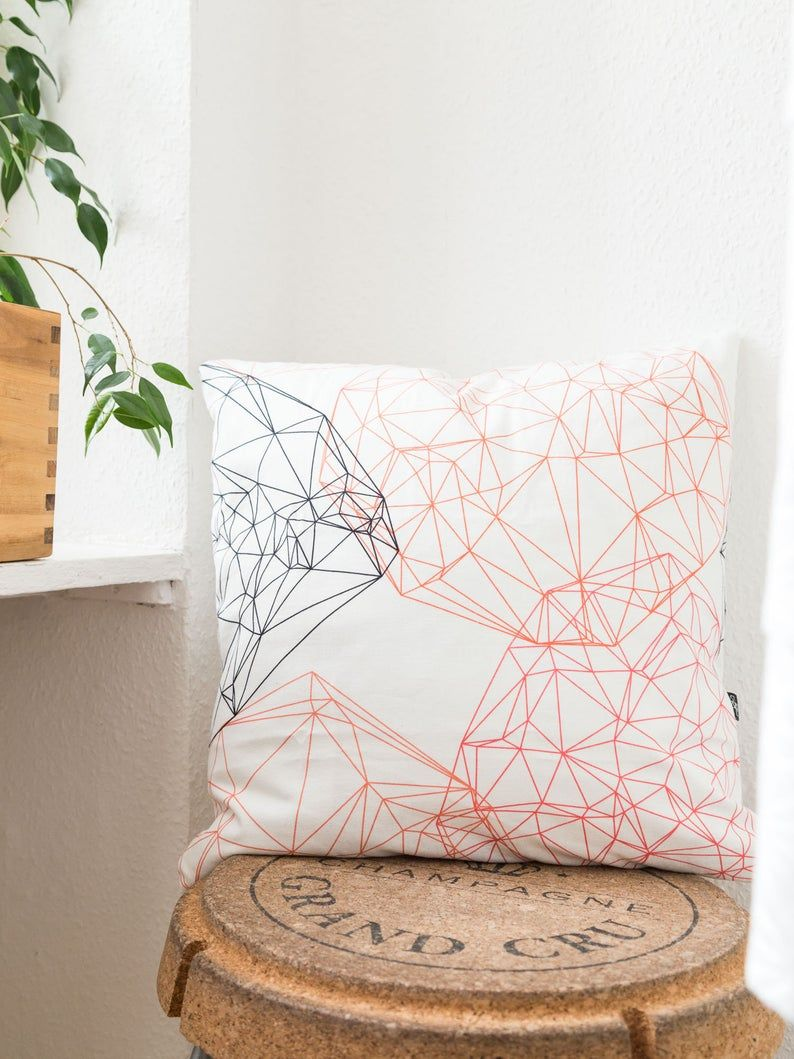 Modern Cushion With Geometric Design Matching The Trend Colour