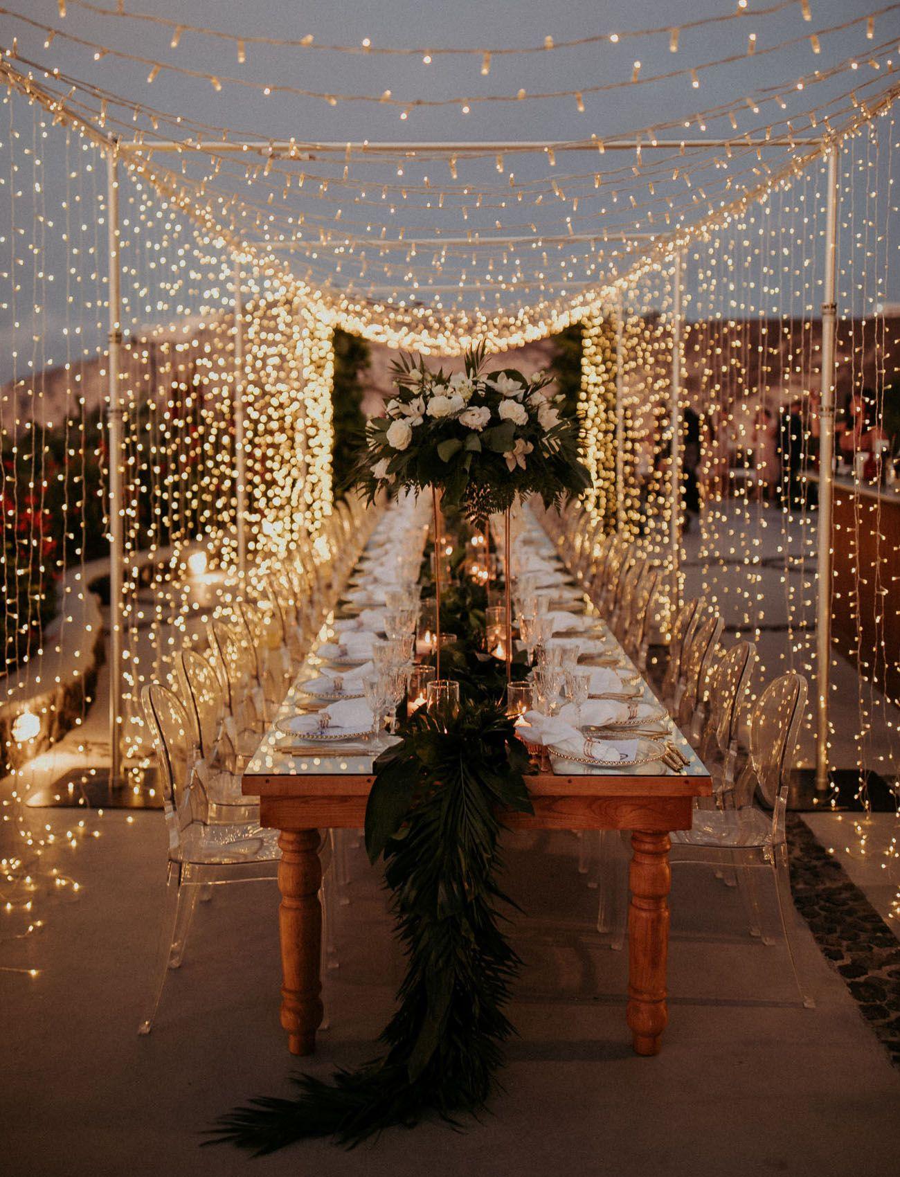 A Magical Santorini Wedding with Fairy Lights + Tropical Florals #fairylights