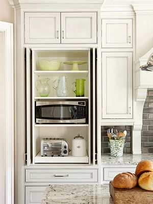 Cabinet With Built In Microwave Coffee Maker On A Pull Out Tray Have Mugs Hooks Also Toaster Er Filters Ground
