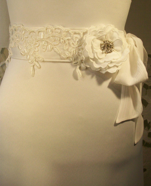 wedding belt sash - Ivory lace belt with vintage fashioned flower brooch. $99.00, via Etsy.