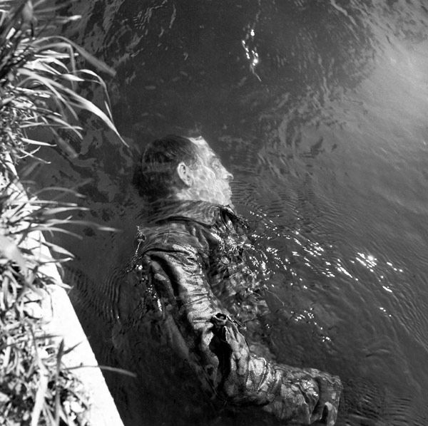 Lee Miller :: Dead SS Guard in the Canal, Dachau, Germany, 1945, © Lee Miller Archives
