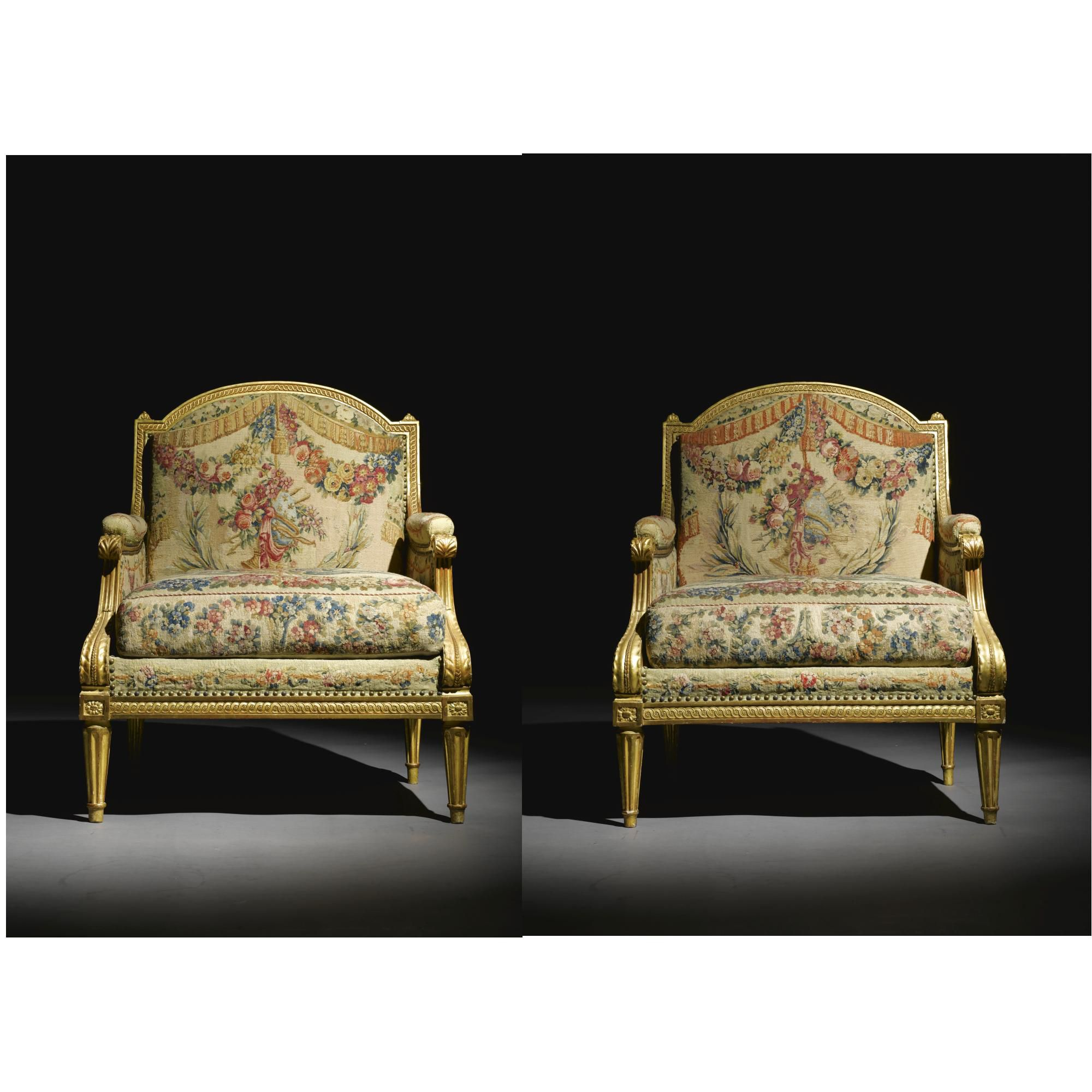 A pair of Carved Giltwood and Beauvais Tapestry upholstered marquises each stamped C.Sené, Louis XVI, circa 1780.