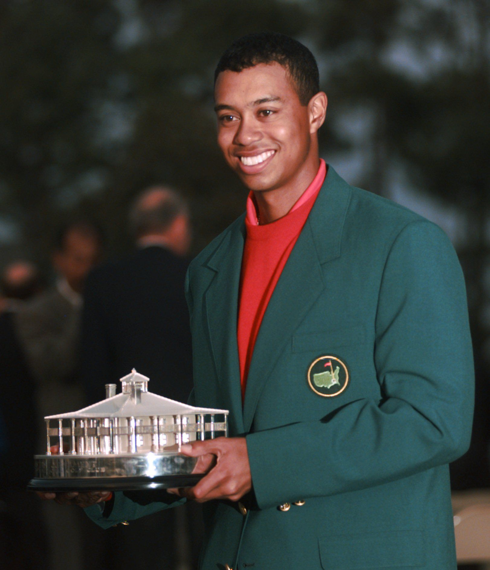 masters champion tiger woods holds a replica of the