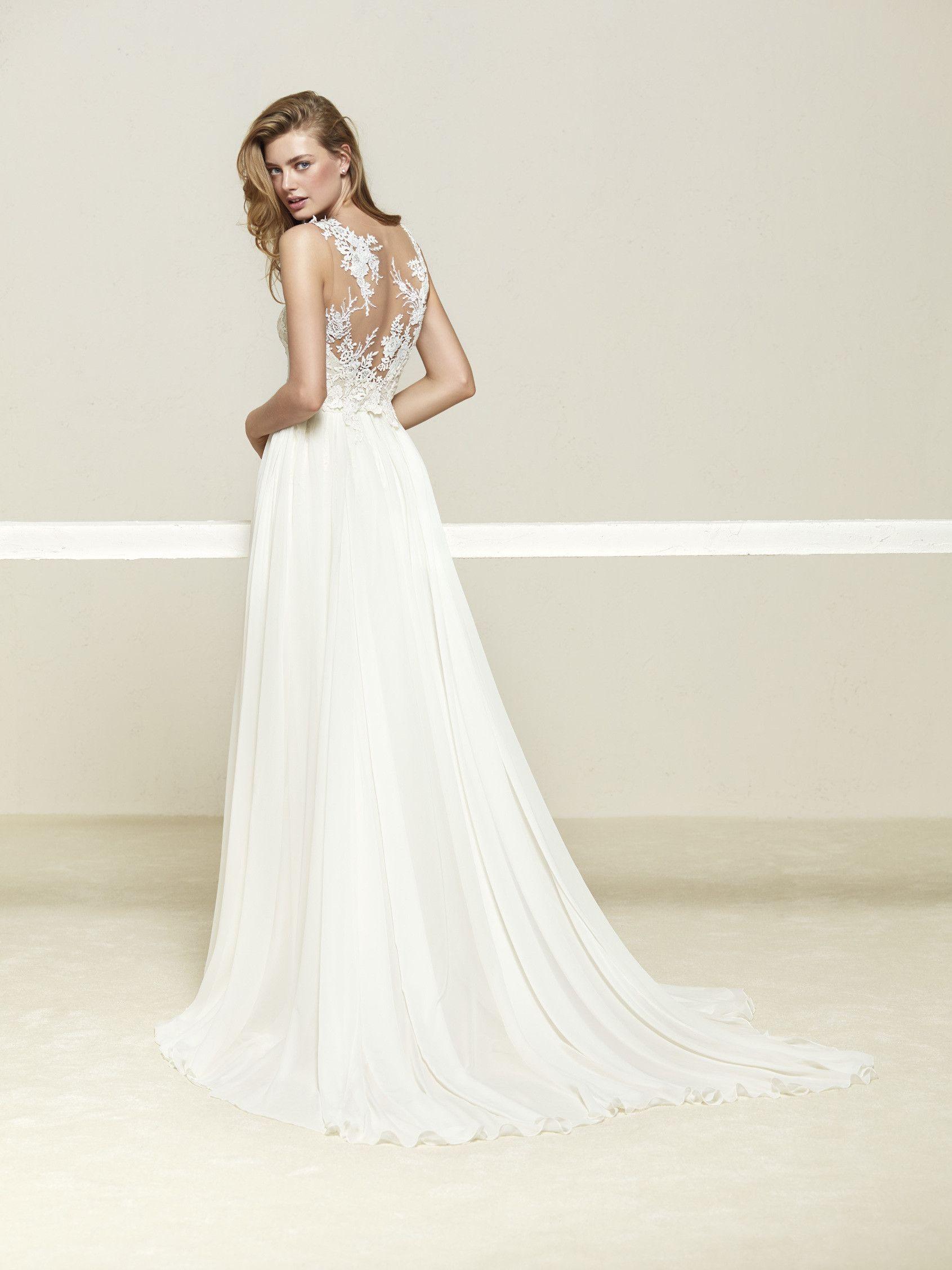 Wedding dress with beautiful layered skirt Drepea Pronovias