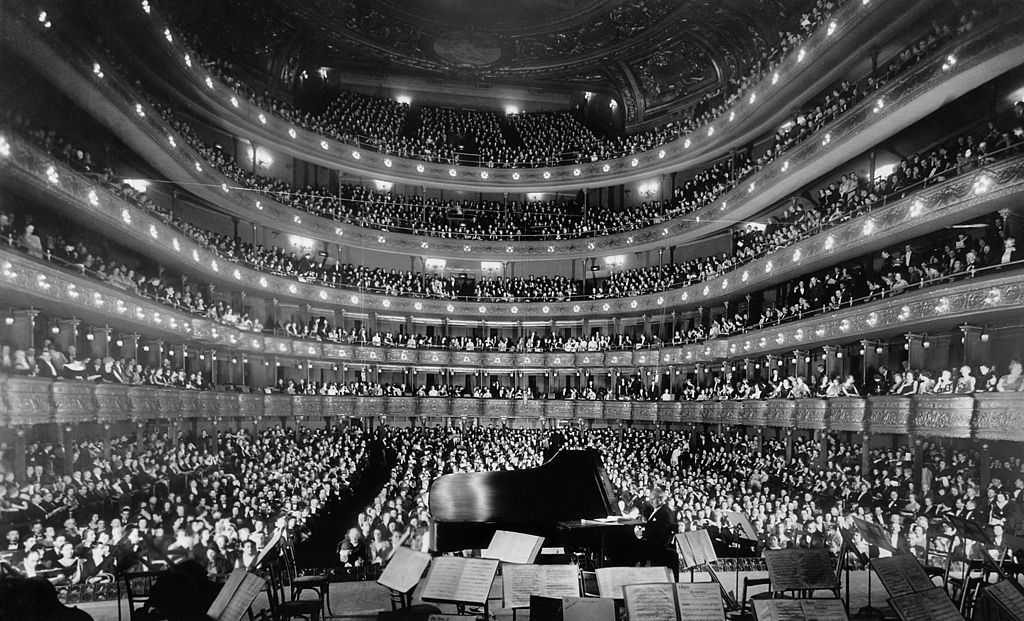 Full house at the Metropolitan Opera House, NYC, on November 28, 1937. This is the view from the rear of the stage looking outward as famous pianist Josef Hofmann plays for the audience. The Metropolitan Opera House was located at 1411 Broadway. Opened in 1883 and demolished in 1967, it was the first home of the Metropolitan Opera Company. It had a seating capacity of 3,625. In addition, there were 224 standing room places. Old Pics New York City! - Page 107 - SkyscraperCity
