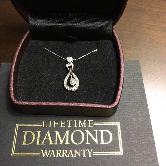 10K White Gold Pendant with 1/4th CT Diamonds 💎. Price: $150 Size: OS