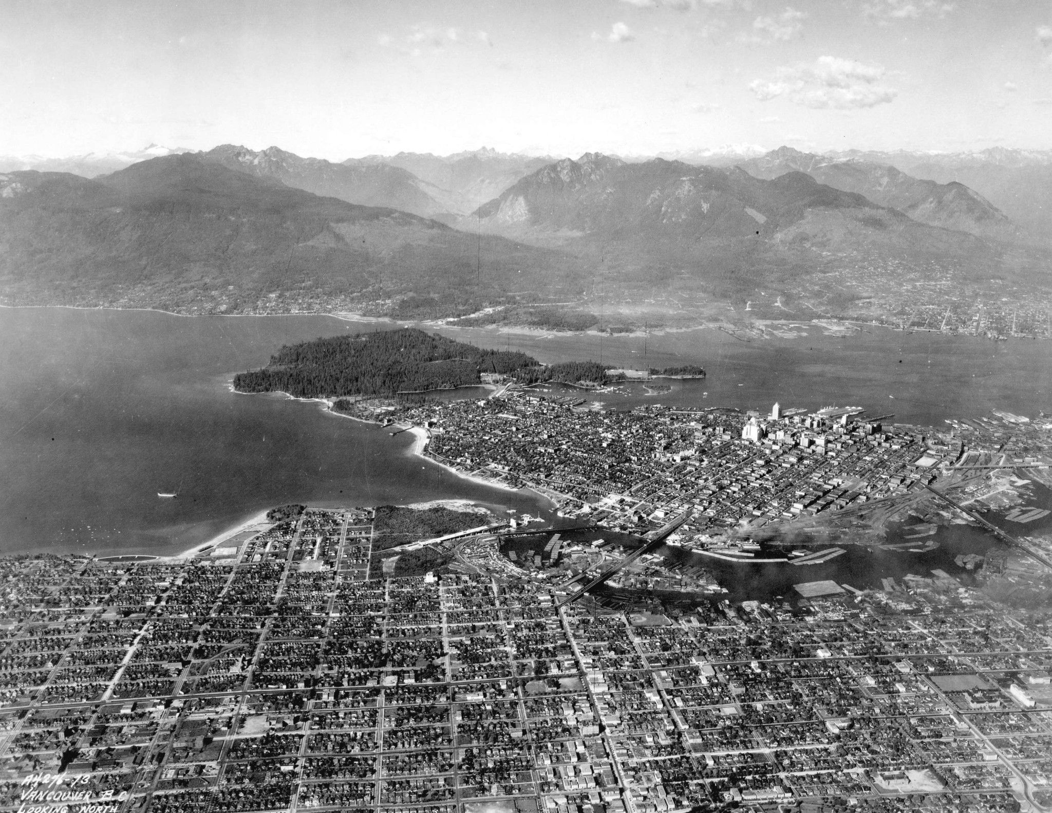 1931: High above Vancouver looking toward the undeveloped North Shore mountains: City of Vancouver Archives