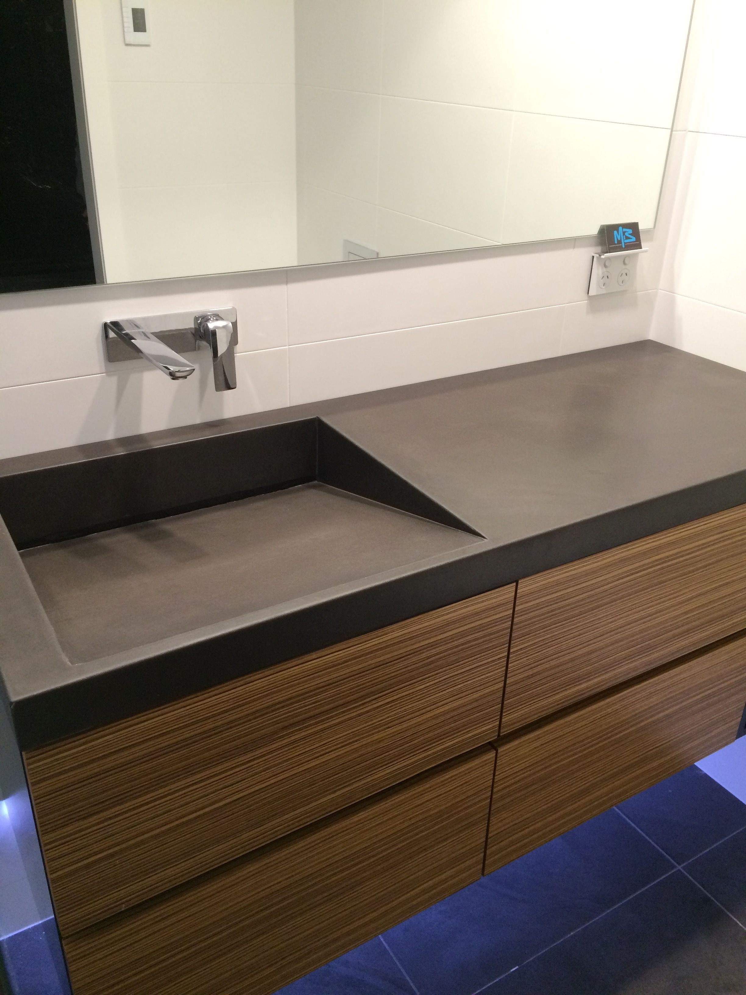 Polished concrete vanity top with integrated sink by Bathroom vanity with integrated sink