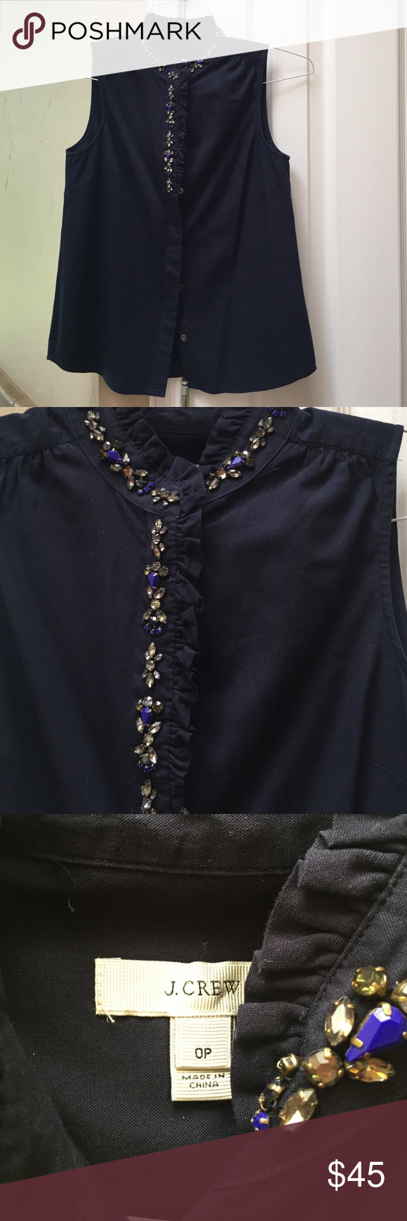 JCrew navy blue jeweled tank. Size 0P Darling navy blue blouse. From JCrew. Worn only a few times, perfect condition! Beautiful jewels and ruffles lining the collar. J. Crew Tops Blouses