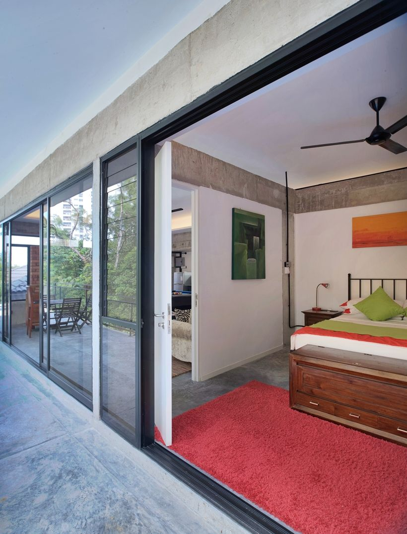 Guest Bedroom Also Utilizes Sliding Glass Doors To Open Up Its Space